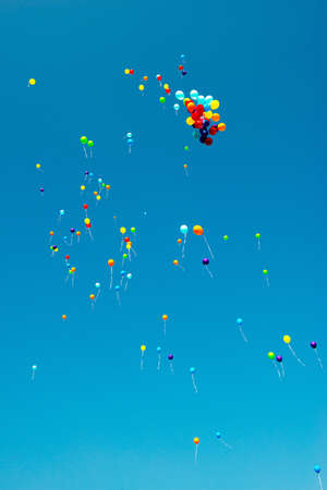 blue and white: a lot of colorful balloons in blue sky Stock Photo