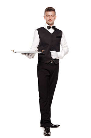 tray: A waiter or bartender, or servant holding a silver tray and smiling. White background.