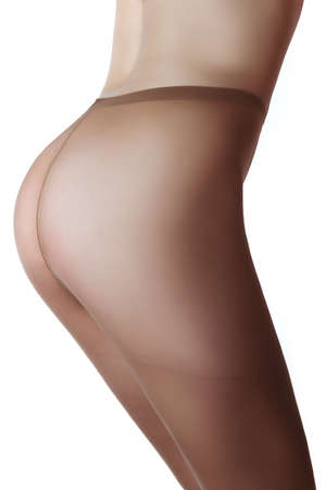 nude female buttocks: Beautiful buttocks of a woman wearing tights. White background, back view.
