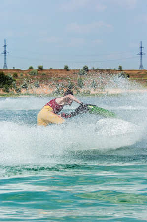 personal watercraft: Young man on jet ski on a bright sunny day