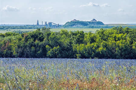 mine data: landscape with a field, the coal mine waste heaps and on the horizon