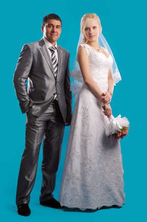 marriageable: Loving newlyweds standing on a blue background