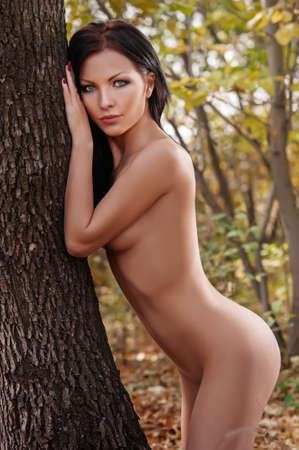 fully nude super sexy woman and very beautiful top model in the autumn forest photo
