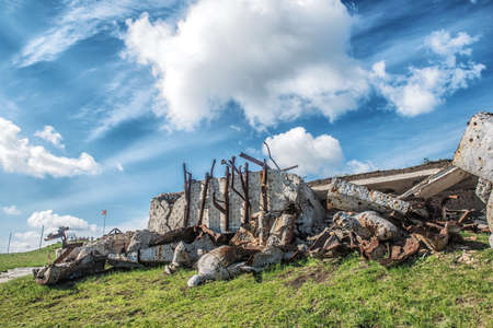 Monument to Soviet soldiers piled rubble, destroyed after the hostilities of 2014. DNR, Ukraine, Saur-Tomb.