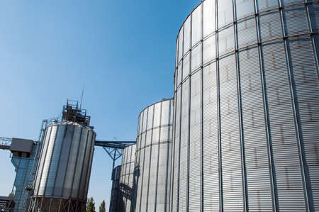 galvanised: Galvanised Iron grain silos on a farm in Eastern Europe Stock Photo