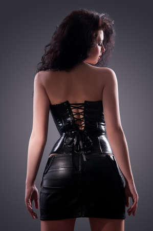 Slim sexy woman with hourglass figure in black leather corset photo