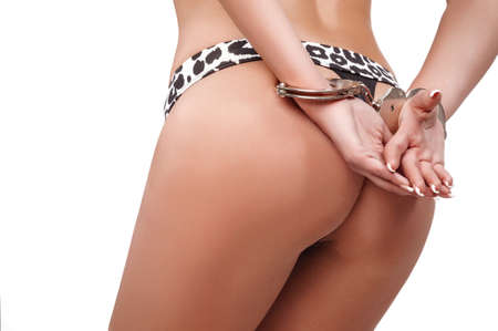 naked girl in handcuffs on a white background photo