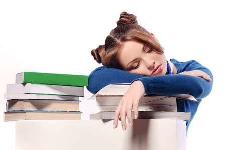 tired student fell asleep on textbooks, isolated photo