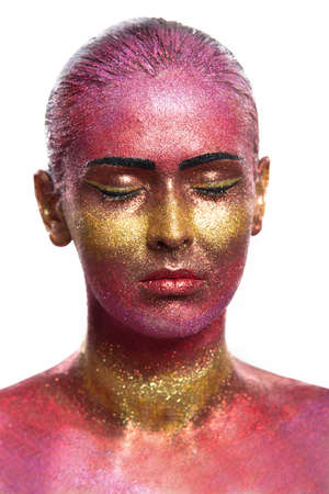 glitter makeup: Glitter makeup on a beautiful woman face on a black background. Creative Contemporary Design Stock Photo