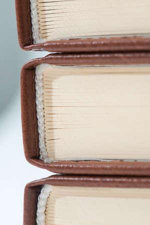 side shot: Three books turned back side shot close-up.