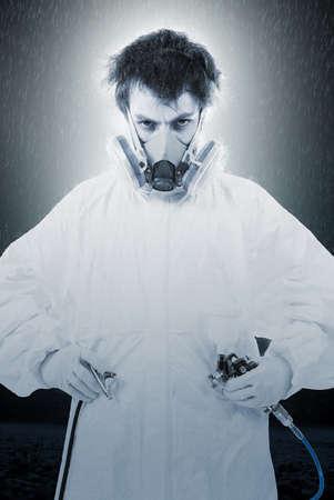gasmask: Worker with airbrush gun, black and white photo Stock Photo