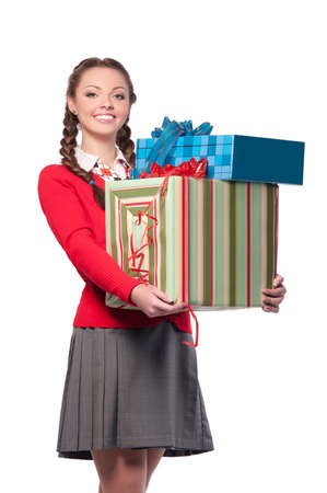 beautiful young woman holding boxes with gifts, isolated background photo
