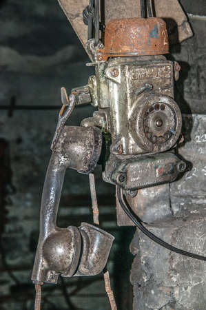 conversation miner, old phone in the mine