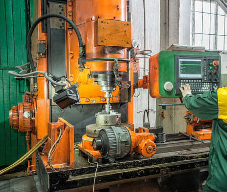 Facing operation of a metal blank on turning machine with cutting tool