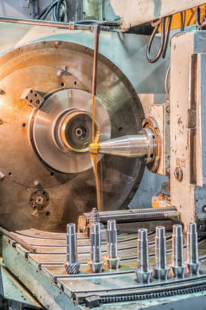 outmoded: Facing operation of a metal blank on turning machine with cutting tool