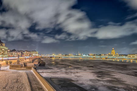 Beatiful night view of the frozen Neva river in Saint Petersburg, Russia