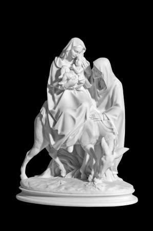 Classical marble statuette of a religious scene with a baby Jesus on a black background