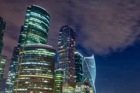Moscow city skyscrapers and reflection in the Moscow river against the blue sky on a summer night Stock fotó