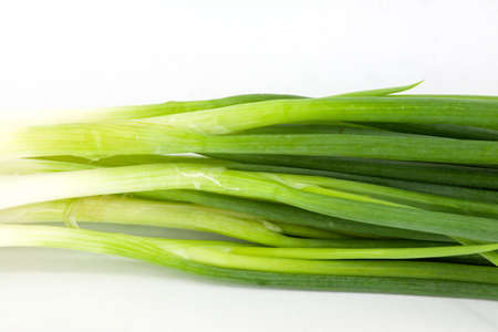Beautiful spring onions  Isolated on a white background