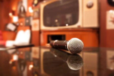Close up of microphone in karaoke room Stock Photo