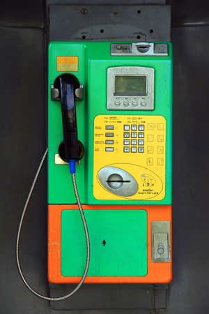 Public coin-operated telephone  Phonebooth  photo