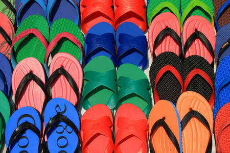 Set of colorful flip flops display on Thailand street market  photo