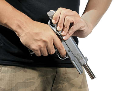 Close up of mans hand reloading gun, Man hold and loading ammunition his pistol on white background. Army, Semi-automatic handgun, 45 pistol.
