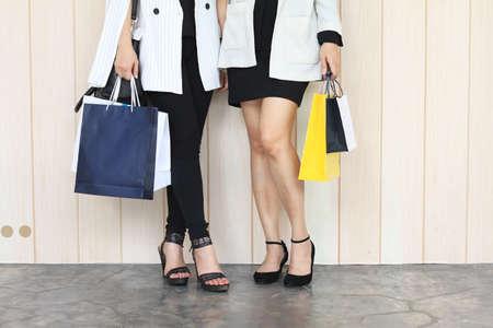 go shopping: Closeup of women holding shopping bags on the street, Lets go shopping, Shopaholic women. Stock Photo