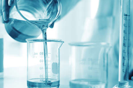 Oil pouring, Equipment and science experiments, Formulating the chemical for medicine, Organic pharmaceutical, Alternative medicine concept. (Selective Focus)