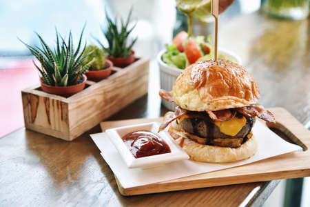 Burgers with beef bacon and cheese. Meat lover. Stock Photo