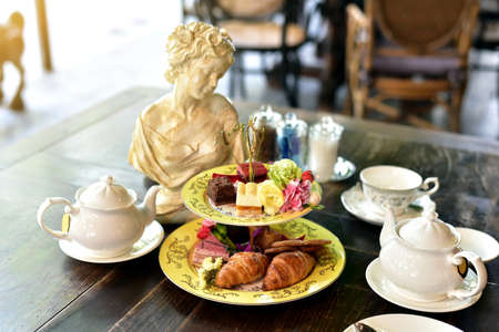 afternoon fancy cake: Afternoon English high tea set, Croissant and cake.