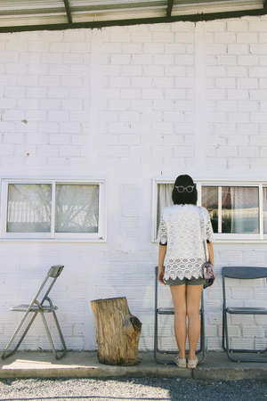 antique furniture: Girl and white brick wall. Minimal Space, Vintage Style. (Soft Light Process)