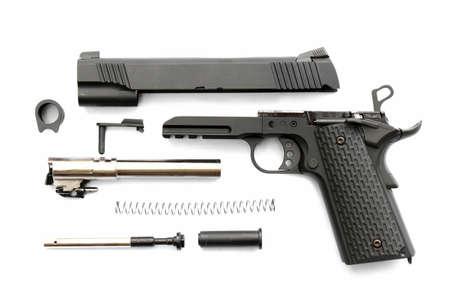 Disassembled handgun on white background. Seperate parts handgun. Pistol Part.