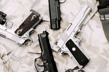 aluminium: Many Guns on Military texture. Handguns on camouflage background. 9mm, 11mm Pistols. (Process With TV Scan line effect)