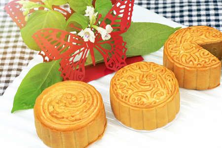 Moon cake, Chinese dessert present in modern fusion style, Traditional dessert for tea break. Stock Photo