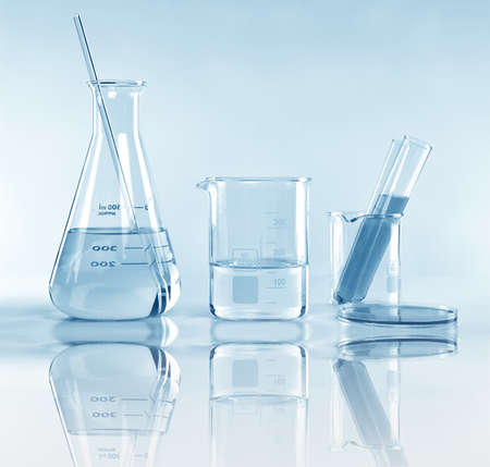 Scientific laboratory experimental glassware with clear solution, Symbolic of science research and development. Imagens