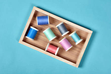 Thread rolls, Group of colorful thread on sewing desk, Craft, sewing and needlework concept. Stock Photo