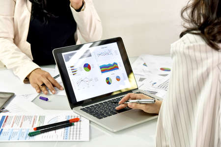 Business strategy planning, Business women discuss and review data documents, Business chart and graph analyzing.