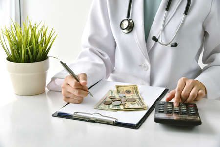 Medical fee, Health insurance, Doctor writing medication note and calculate the examination charges in hospital, Money saving for healthcare services.