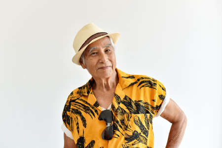 Cheerful asian senior old man, Confident and smiling elderly people in colorful hawaii shirt, Happy retiree citizen and travel concept.