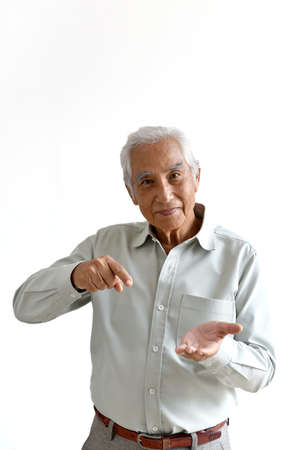Asian senior old man, Confident and smiling elderly people with hand pointing gesture on white background, Hand mock up for ads product, Happy retiree citizen concept. Фото со стока