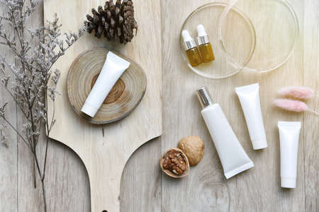 Cosmetic bottle containers packaging with winter seasonal theme, Blank label for organic branding mock-up, Natural skincare beauty product concept.