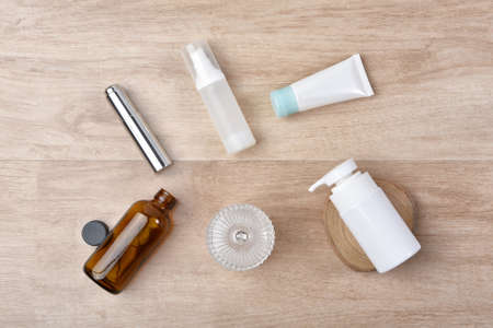 Set of cosmetic bottle container on wooden background, Skin care blank label for branding mock-up.
