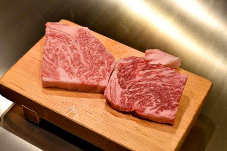 Wagyu beef steak, Chef present the luxury A5 grade kobe meat on cutting board, Premium finest cuisine dinner. Stock Photo