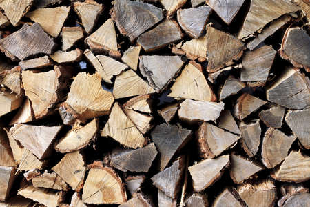 Stack of firewood, Textured of dry chopped logs for wallpaper, Natural wood background for design template.
