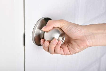 Hand opening door, Door knob, Touching public surface transmission germ virus. Archivio Fotografico