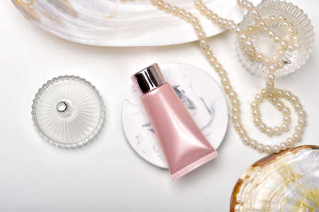 Cosmetic bottle containers with marine pearl extraction essence, Blank label for organic branding mock-up, Natural skincare beauty product concept. Stock Photo