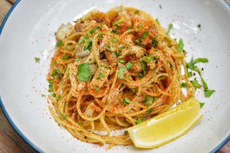 Spicy crab pasta, Seafood spaghetti with chilli pepper, Favorite fusion italian dish in restaurant.