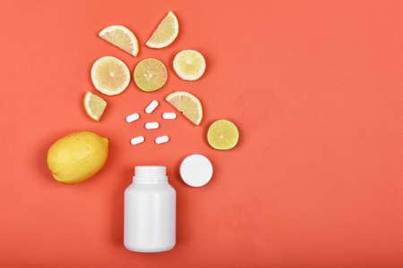 Natural medicine supplement from lemon on orange Archivio Fotografico