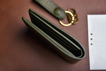 Leather wallet, Close up detail of handcraft full grain vegetable tanned olive green wallet, Men fashion and accessory.